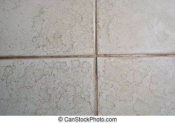 Close up of bathroom floor tile texture with water stain spot.