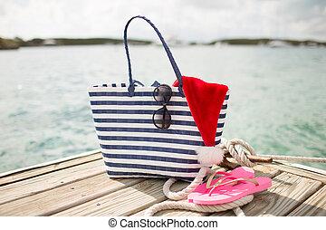 close up of beach accessories and santa helper hat - beach,...