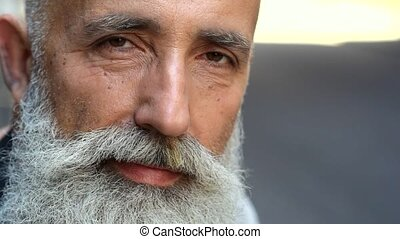 Close up of bearded man looking into camera