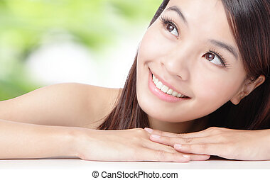Close up of beautiful asian woman face with green background
