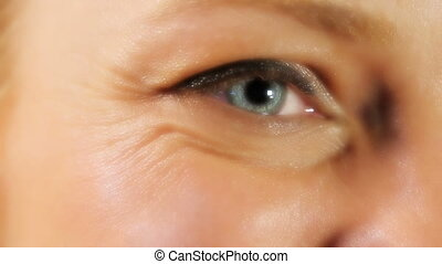 Close up of beautiful blue eyes of woman, studio