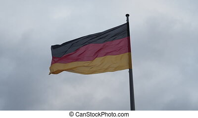 Close up of beautiful German Flag waving in the Wind with Overcast