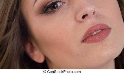 Close-up of beautiful girl smiling