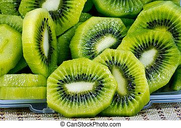 close up of beautiful kiwi fruit slices background