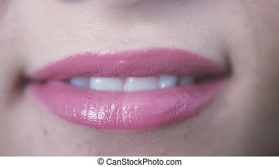 Close up of beautiful pink lips smiling of young girl with open mouth and teeth