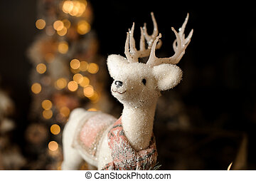 close-up of beautiful sparkling christmas toy in the form of white deer with antlers