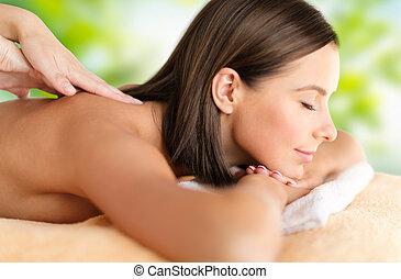 close up of beautiful woman having massage at spa