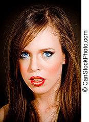 close up of beautiful woman looking at camera