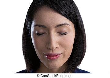 Close-up of beautiful woman with eyes closed