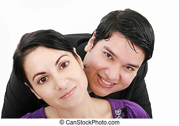Close-up of beautiful young couple isolated on white background