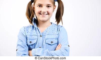Close up of beautiful young teenage girl smiling at the camera