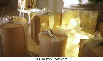 Close up of beautifully decorated boxes with gifts inside prepared for Christmas.