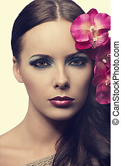 close up of beauty girl with flowers. FAKE FLOWERS