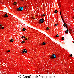 Close-up of beef red meat with black pepper