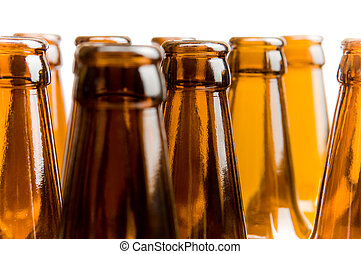 Close-up of beer bottles, focus on middle one