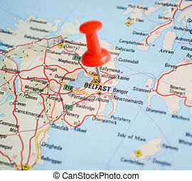 Close up of Belfast map with red pin - Travel concept