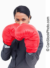 Close up of belligerent saleswoman with boxing gloves ...