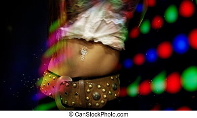 close up of belly of girl dancing at club