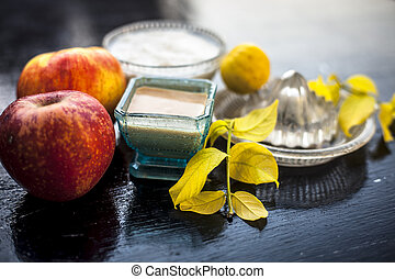 Close up of best home remedy or face pack for better skin complexion on wooden surface i.e. Apple pulp well mixed with lemon juice and curd. Top shot.