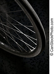 bicycle whee - Close up of bicycle wheel in sparse light