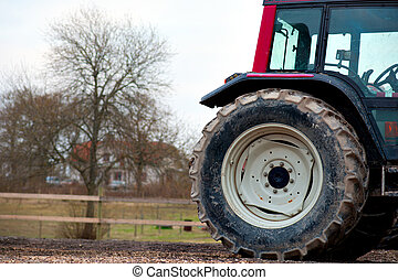 tractor whee - Close up of big tractor wheel in front of...