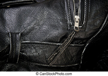 close up of black leather police jacket