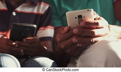 Close-up Of Black Male Hands Holding Mobile Phone Telephone Smartphone