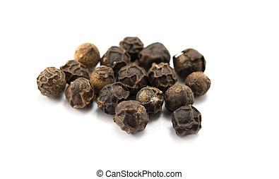 black peppercorns - close up of black peppercorns in ...