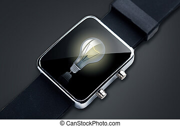 close up of black smart watch with light bulb