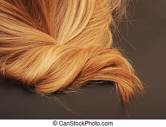 close-up of blond hair on black background
