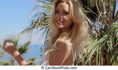 Close Up of Blond Woman in Tropical Location