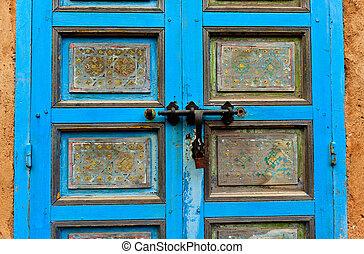 Close up of blue door and deadbolt lock - Rabat, Morocco:...