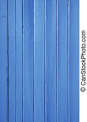 Close up of blue painted wooden fence panels.