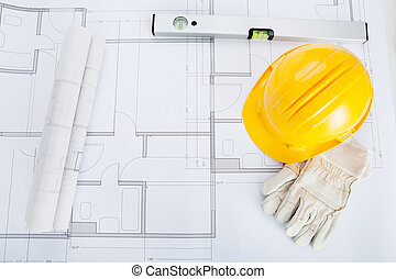 Close-up Of Blue Print And Hard Hat - Close-up Of Hand...