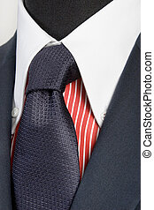 blue suit with tie and red striped shirt - close up of blue...