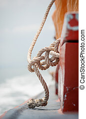 Close up of boat rope on boardside of the ship