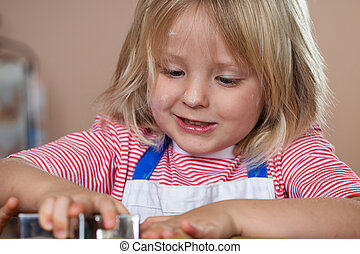 Close-up of boy making gingerbread cookie