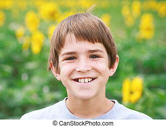 Boy Smiling in a Flower Field