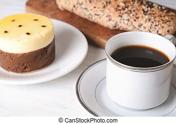 Close up of bread, coffee and cake.