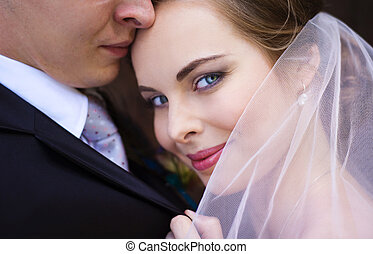 Close up of bride and groom face