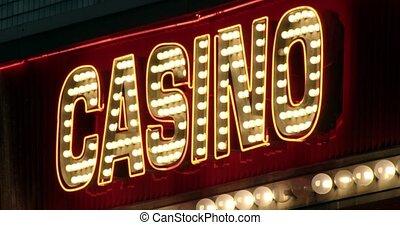 Close up of bright illuminated sign that says CASINO