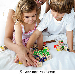 Close-up of brother and sister playing with cube toys
