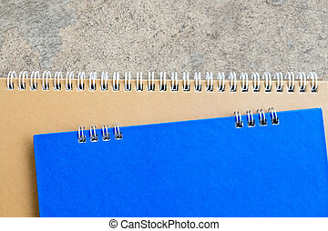 brown and blue blank notebook with spiral