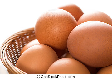 Close Up of Brown Chicken Eggs in Basket