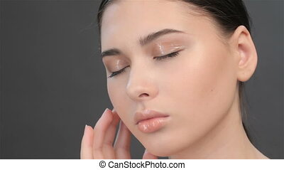 Close up of brunette girl with closed eyes