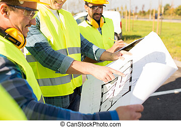 close up of builders with blueprint at building - building,...