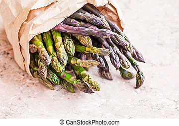 Close up of bunch of fresh asparagus spears on the pink ...