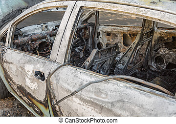Close-up of Burned Out Car on the Street