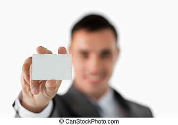 Close up of business card being shown by businessman