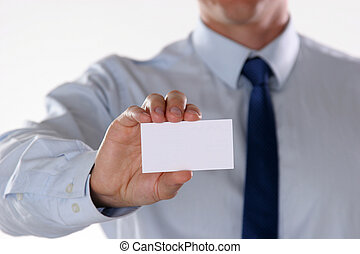 Close-up of business card in mans hand